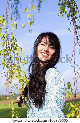 Happy girl on spring breeze - stock photo