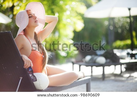 happy girl on sunbed - stock photo