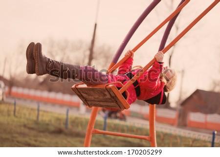 happy girl on swing - stock photo