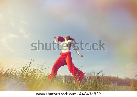 Happy girl on the grassland - stock photo