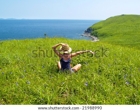 happy girl  on the meadow - stock photo