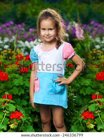 Happy girl on the meadow with flowers - stock photo