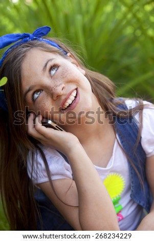 Happy girl on the phone - stock photo
