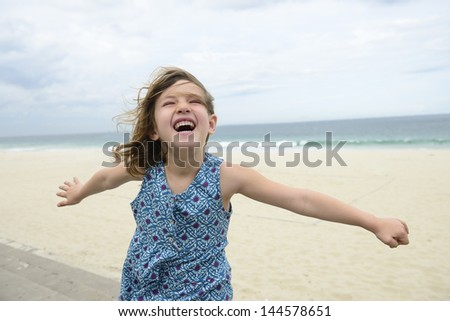 happy girl outdoors on the beach - stock photo