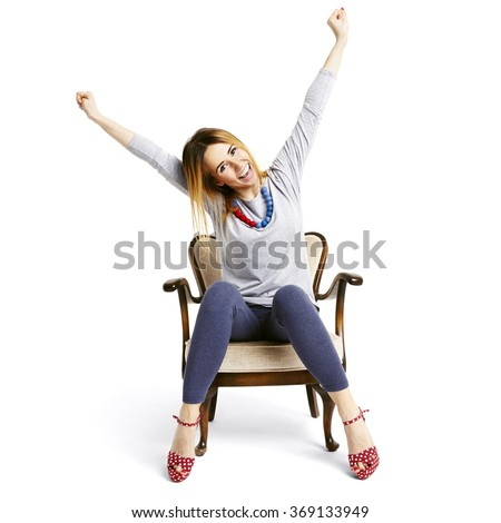 Happy girl raises her arms in a gesture of victory. - stock photo