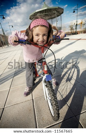 Happy girl riding a bike