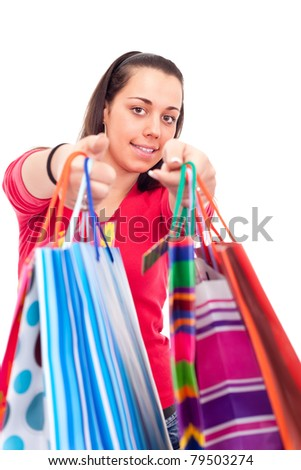 happy girl shoving  shopping bags after shopping, isolated on white background