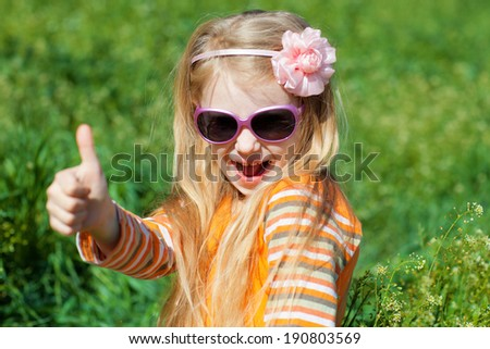 happy girl showing sign okay with fingers - stock photo