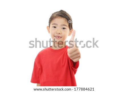 Happy girl showing thumb up sign