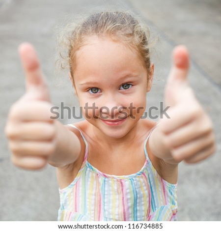 happy girl shows gesture cool - stock photo