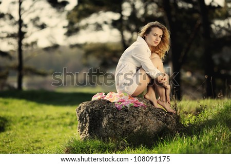happy girl sitting on the bench - stock photo