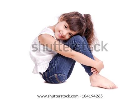 Happy girl sitting on the floor - stock photo