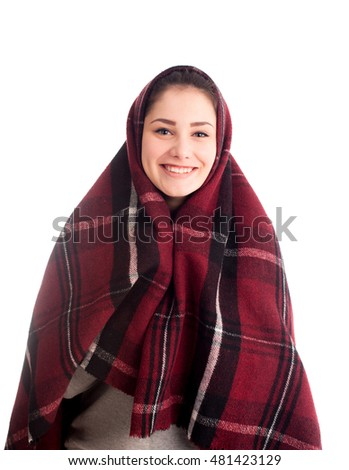 Happy girl smile covered with blanket isolated on white