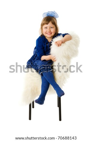 Happy girl smiling sitting isolated on white