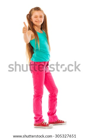 Happy girl stand with thumb up gesture - stock photo