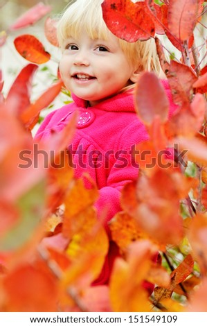 happy girl standing in bushes - stock photo