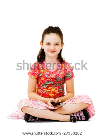 Happy girl text messaging on a mobile phone isolated over white - stock photo