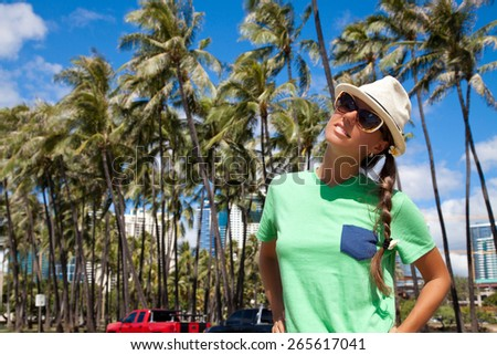 Happy girl walking in Honolulu City, Oahu, Hawaii, USA. Vacations And Tourism Concept. Summer luxury vacation in Hawaii. - stock photo