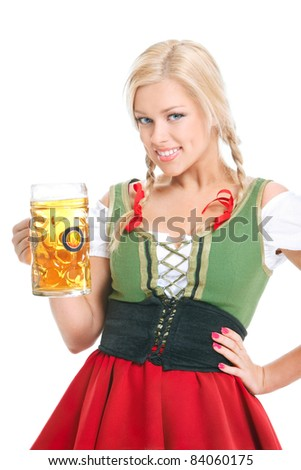 happy girl wearing a dirndl with beer mug over white - stock photo