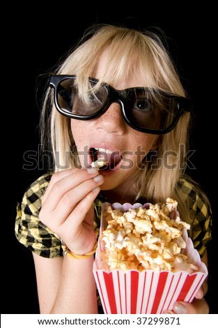 Happy Girl Wearing New Style 3-D Glasses in a Movie Theater - stock photo