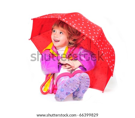 happy girl wearing raincoat and boots with umbrella - stock photo