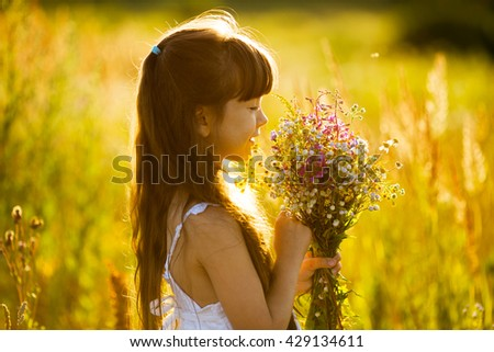 Happy girl with a bouquet of yellow flowers - stock photo