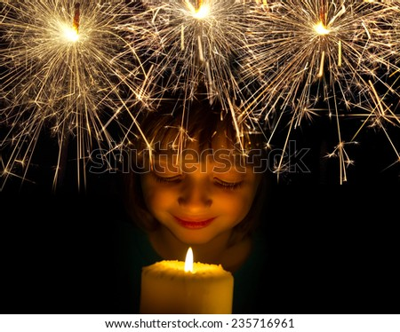 happy girl with a candle and sparkler - stock photo
