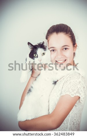 happy girl with a cat in her arms