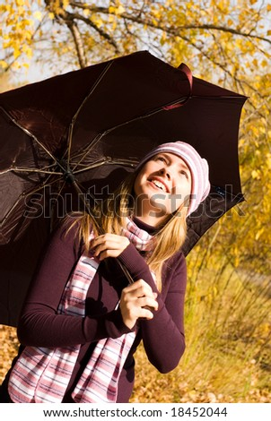 happy girl with an umbrella in the park - stock photo