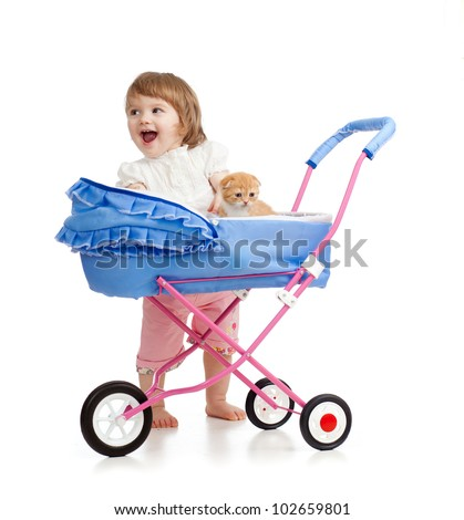 happy girl with baby carriage and kitten inside - stock photo