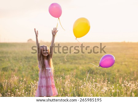 happy girl with  balloon outdoor - stock photo