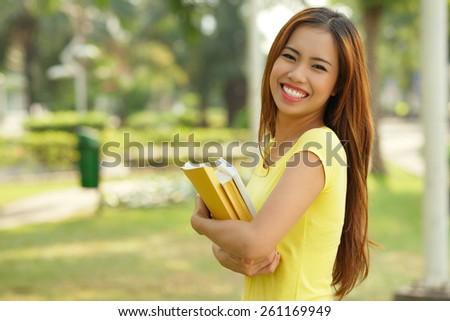 Happy girl with books - stock photo