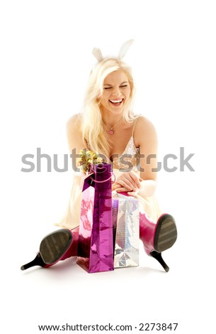 happy girl with bunny ears and gifts over white - stock photo