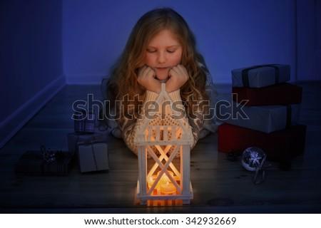happy girl with Christmas lantern indoor - stock photo