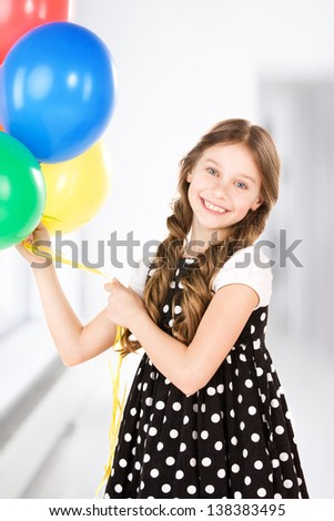 happy girl with colorful balloons at home - stock photo