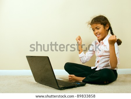 happy girl with computer - stock photo