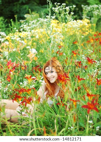 Happy girl with flower - stock photo