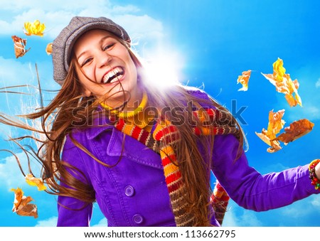 happy girl with foliage in autumn - stock photo
