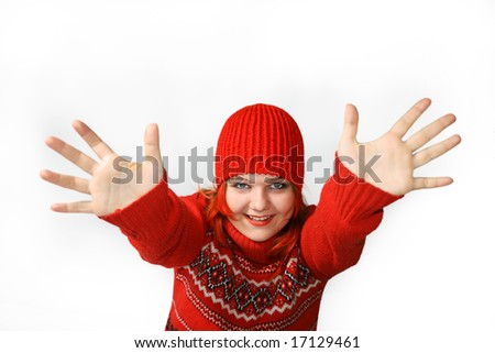 Happy girl with hands up in the red cap Against the white background. - stock photo