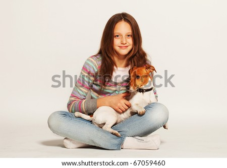 happy girl with Jack Russell Terrier - stock photo