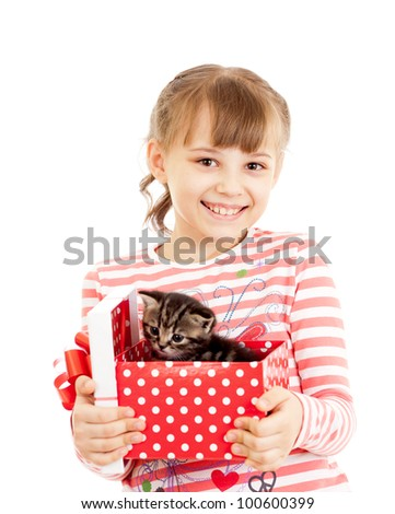 Happy girl with kitten in gift box - stock photo