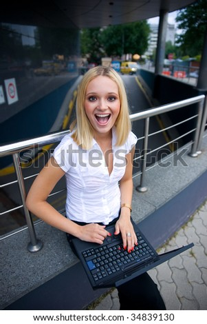 happy girl with laptop outside - stock photo