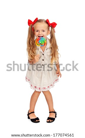 Happy girl with large lollipop candy - isolated - stock photo