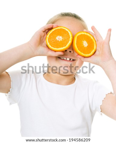 Happy girl with oranges, isolated over white - stock photo