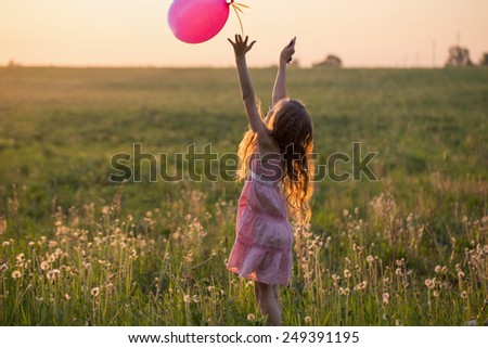 happy girl with pink balloon outdoor - stock photo