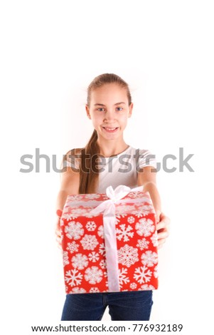 Happy girl with present box isolated on white