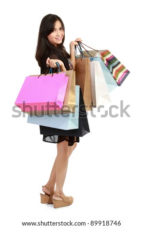 happy girl with shopping bags in isolated white background - stock photo