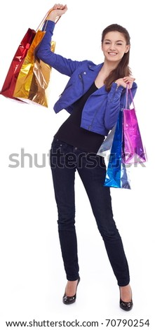 Happy girl with shopping bags. Isolated on a white background - stock photo