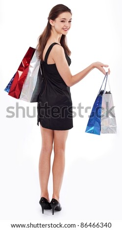 Happy girl with shopping bags. Isolated on a white background. - stock photo
