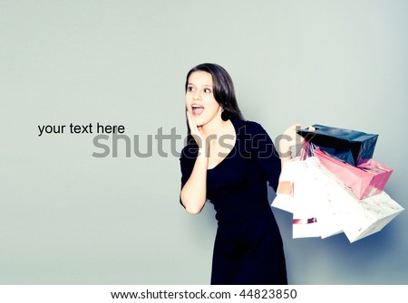 happy girl with shopping bags isolated on white - stock photo